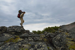 Young woman tourist walking on top of the mountain ridge Barguzi Royalty Free Stock Photos