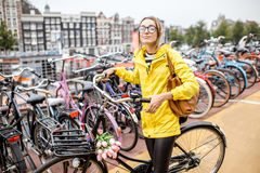 Woman parking a bicycle in Amsterdam Stock Photos