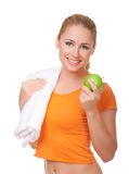 Young woman with towel and apple Stock Photos