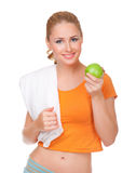 Young woman with towel  and apple Stock Photography