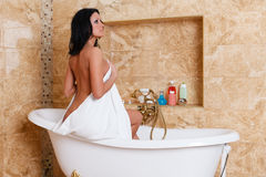 Young woman with towel in bathroom. Stock Images