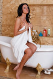 Young woman with towel in bathroom. Royalty Free Stock Photos
