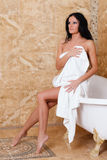 Young woman with towel in bathroom. Royalty Free Stock Image