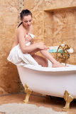 Young woman with towel in bathroom stock images