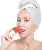 Young woman in towel, with a berry Stock Photo