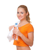 Young woman with towel and bottle with water Royalty Free Stock Image