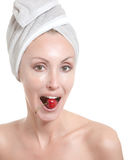 Young woman in towel, with a cherry berry Stock Photos