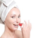Young woman in towel, with a cherry berry Stock Image