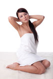 Young woman in towel. Concept spa. Stock Photos