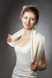 Young woman with towel after fitness exercise Stock Image