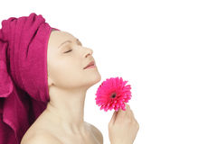 Young woman with towel and gerbera flower Stock Photography