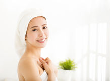 Young woman with a towel on her head after bath Royalty Free Stock Images