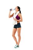 Young woman with towel on neck drinks water Stock Images