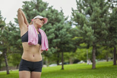 Young woman with towel after sports activity Stock Photos