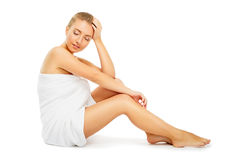 Young woman in towel terry sits on  floor Stock Images