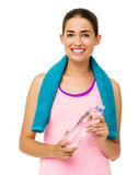 Young Woman With Towel And Water Bottle Royalty Free Stock Image