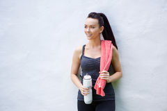Young woman with towel and water bottle after workout Stock Photos
