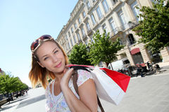 Young woman in town shopping Royalty Free Stock Image