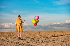 Young woman with toy balloons Royalty Free Stock Images