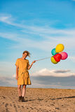 Young woman with toy balloons Stock Images