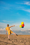 Young woman with toy balloons Royalty Free Stock Photography