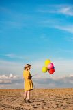 Young woman with toy balloons Stock Photography