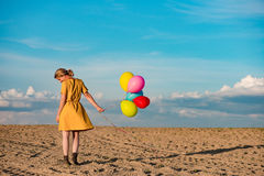 Young woman with toy balloons Royalty Free Stock Photo