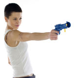 Young woman with toy gun Stock Images