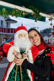 Young woman with a toy of santa Royalty Free Stock Photos