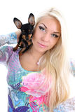 Young woman with toy-terrier on her shoulder Royalty Free Stock Images
