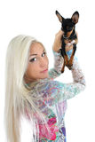 Young woman with toy-terrier over white Stock Photography