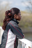 Young woman in track suit in profile Royalty Free Stock Photography