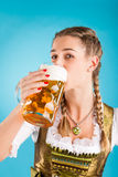 Young woman in traditional clothes  or dirndl Stock Photo