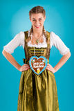 Young woman in traditional clothes - dirndl or tracht Royalty Free Stock Images