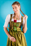 Young woman in traditional clothes - dirndl or tracht Royalty Free Stock Photos