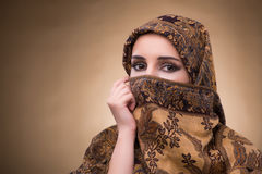 The young woman in traditional muslim clothing Stock Image