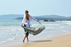 Young woman in the traditional punjabi dress. On Patnam beach. South Goa, India Royalty Free Stock Photos