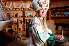 Young woman in traditional yurt dwelling. Royalty Free Stock Images