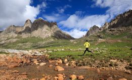 Runner running at high altitude mountains Stock Photography