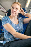Woman corrected her hair in the train Stock Images