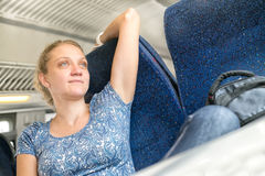 Woman relaxed in the train Stock Image