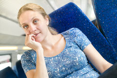 Women think about something in a train Royalty Free Stock Photos
