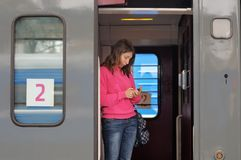 Young woman in a train Stock Photography