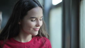 Young woman in train. Young smiling woman in train using smartphone stock video