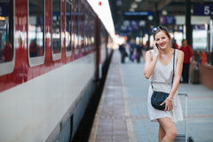 Young woman at a train station Royalty Free Stock Image