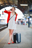 Young woman at a train station Stock Photo