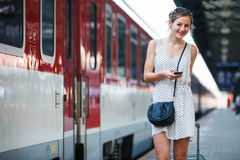 Young woman at a train station Royalty Free Stock Images