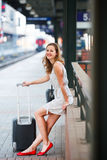 Young woman at a train station Stock Photography