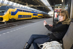 Young Woman at Train Station Stock Images
