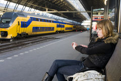 Young Woman at Train Station royalty free stock image